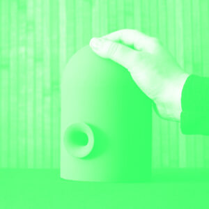Hand on speaker-like object in duotone green