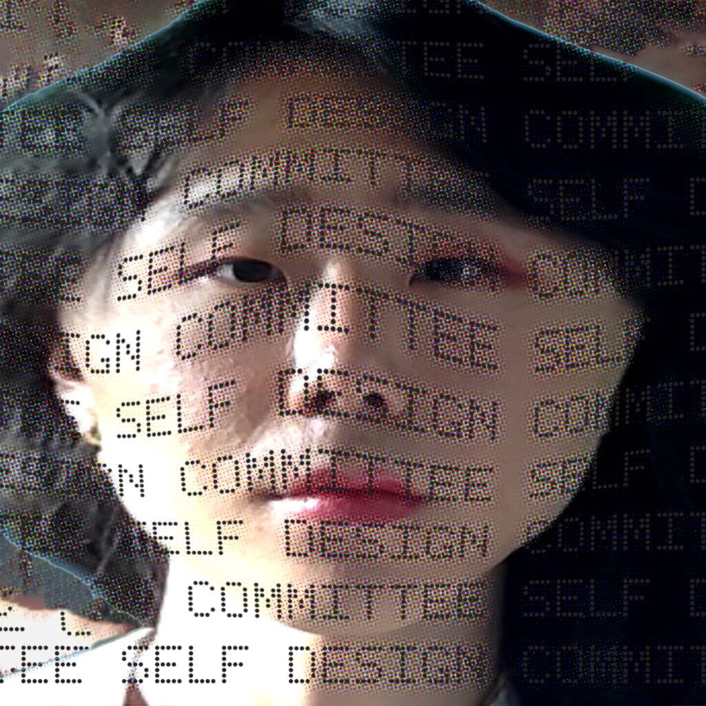 face with 'self design committee' projected on it
