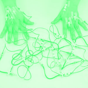 hands attached to tubes in duotone green
